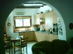 The kitchen come dinning room boasts a lovely arch way. - click to enlarge