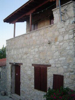 One bedroom illage house for sale in Lofou village in Cyprus. - Traditional beamed ceilings and a balcony off of the bedroom that overlooks the village walkway below.
