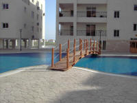 One bedroom flat on a small complex in Oroklini, near Larnaca in Cyprus for sale with sculpted shared swimming pool.