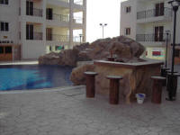 One bedroom flat on a small complex in Oroklini, near Larnaca in Cyprus for sale - built in pool bar.