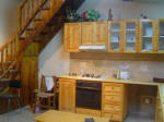 Lofou village property for sale - Wooden staircase that leads up to the single bedroom with an en-suite shower room. - click to enlarge